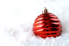 Red Christmas tree decoration in snow Royalty Free Stock Images