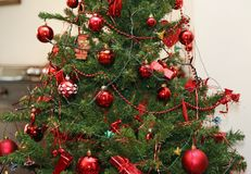 Red Christmas tree decorations and glittering balls Stock Photo