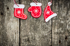 Red Christmas tree decorations on grunge wood Stock Photography