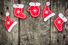 Red Christmas tree decorations on grunge wood. Background. Winter holidays concept. Copy space for your text Royalty Free Stock Photography