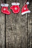 Red Christmas tree decorations on grunge wood Royalty Free Stock Photos