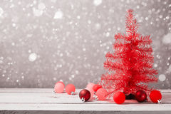 Red christmas tree with decorations on wooden table Stock Photography