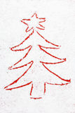 Red christmas tree drawn in the snow Royalty Free Stock Images