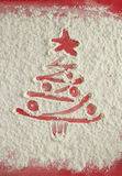 Red Christmas tree on flour background. White flour looks like s Stock Photo