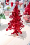 Red Christmas tree foam model decorated with little tinsel garla Royalty Free Stock Photography