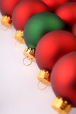 Red Christmas Tree Ornaments with one green. Closeup, still life of Red Christmas Tree Ornaments with one green one Royalty Free Stock Photography
