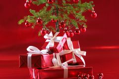 Red Christmas tree, red presents Stock Image