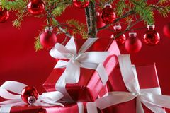 Red Christmas tree, red presents Stock Photos