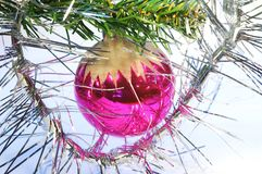 Red christmas tree toy. Reflective, purple, round hanging christmas tree toy stock image