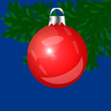 Red Christmas-tree toy on a blue background. Green branch Stock Photos