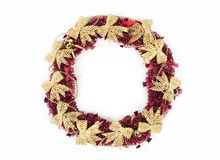 Red christmas wreath isolated on white background. Red christmas wreath with gold bows isolated on white background Stock Photo