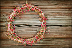 Red Christmas wreath on a wooden background Royalty Free Stock Images