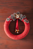 Red christmas wreath on wooden background Stock Images