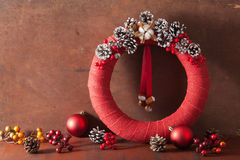 Red christmas wreath on wooden background Royalty Free Stock Photo