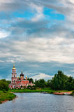 Red church with beautiful cloudscape Stock Photo