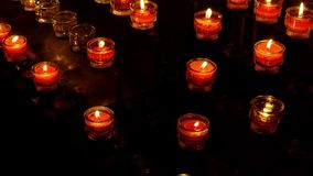Red Church candles in darkness.  stock video footage