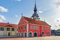 Red church at central square of Bauska town in Latvia.  stock photography