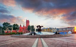 Red Church or Church Of Saints Simon and Helen, Fountain at independence Square in Minsk, Belarus stock image