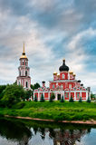 Red church on coast of the lake Royalty Free Stock Photo