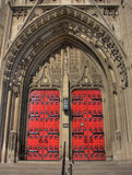 Red Church Doors. Big red doors for a limestone gothic church Royalty Free Stock Photo
