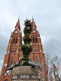 Red church and Easter eggs tree, Lithuania royalty free stock photo