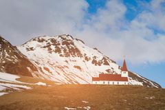Red church on high hill. With snow mountain background Royalty Free Stock Photo