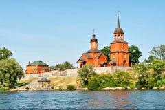 Red church in Ukrainian countryside Stock Photos