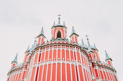 Red church with white strips in Gothic style. Royalty Free Stock Images