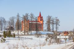 Red church in winter time Royalty Free Stock Photos