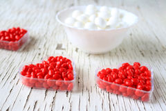 Red cinnamon hearts in a heart shape Royalty Free Stock Photography