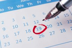 Red circle on calendar Royalty Free Stock Image
