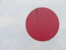 Red circle dot on a white grid background Stock Photography