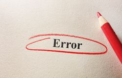 Red circle error. Error circled in red pencill on textured paper royalty free stock image