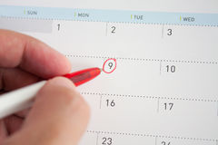 Red circle mark on the calendar. Closeup Royalty Free Stock Image