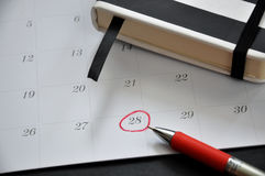 Red Circle Marked on Date 28. On calendar Stock Photo