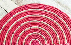 Red circle mat on wooden floor Stock Photos