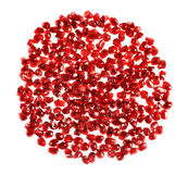 Red circle shape made of pomegranate seeds Stock Image