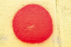 Red circle on the yellow wall - background royalty free stock photos