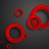 Red circles on black background Stock Photography