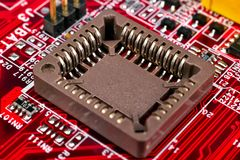 Red circuit board with processors Royalty Free Stock Photos