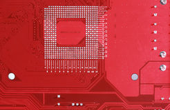 Red circuit board texture background of computer motherboard Stock Photography