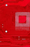 Red circuit board texture background of computer motherboard Royalty Free Stock Image