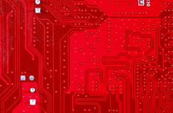 Red circuit board texture background of computer motherboard Stock Images