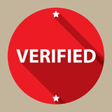 Verified. Red circular label with text 'verified' in white bold uppercase letters, white stars above and below, pale beige background Royalty Free Stock Photography