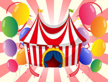 A red circus tent with colorful balloons stock illustration