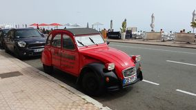Red Citroen 2CV. Menton, France - March 30, 2017: Historic French Car Citroen 2CV Parked In The Street Of Menton On The French Riviera. The 2CV Was Built From stock video footage