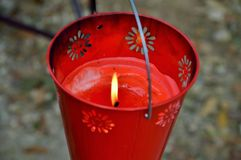 Red citronella candle bucket Royalty Free Stock Image