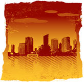 Red city on torn orange paper. Stock Images