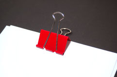 Red Clasp and Paper. Hi-res photo of red clasp and empty papers Royalty Free Stock Photos
