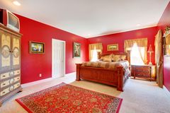 Red classic bedroom with large bed. Royalty Free Stock Photos